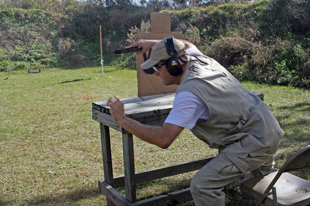 Glock 34 pointed safely downrange, Dave Blazek bolts from seated position en route to winning Enhanced Service Pistol victory.